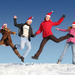 Many jumping on snow — Stock Photo