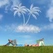 Lying couple on grass and dream island collage — Stock Photo
