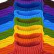 Group of multi color rainbow sweaters collage — Stock Photo