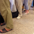 Legs luggage queue — Stock Photo #7432815