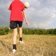 Boy with ball on meadow — Stock Photo