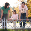 Stock Photo: Family in park at parapet