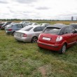 Stock Photo: Cars on meadow