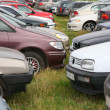 Stock Photo: Many cars on grass