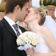 Bride and fiance are kissed against the background of temple Vasiliya Bless - Stock Photo