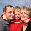 Grandmother and grandfather with the grandson — Stock Photo #7433109