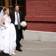 Stock Photo: Bride and fiance on the street