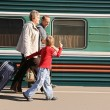 Grandmother and grandfather with the grandson on station — Stock Photo