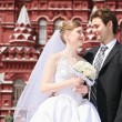 Fiance and bride against the background of historical museum in Moscow — Stock Photo