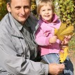 Stock Photo: Grandfather with the granddaughter in the park in autumn 2