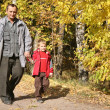 Grandfather with the grandson walk in park in autumn — Stock Photo #7433160