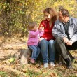 Mother with the daughter and the grandfather in the park in autumn — Stock Photo