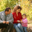 Mother with the daughter and the grandfather in the park in autumn 2 — Stock Photo