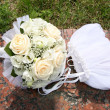 Bag and the bouquet of the bride — Stock Photo