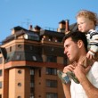 Stock Photo: Child on the shoulders of the father