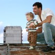 Stock Photo: Father with the child on the roof