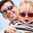 Father with the child in the sunglasses — Stock Photo