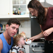 Father, mother and child on the kitchen — Stock Photo