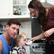 Father, mother and child on the kitchen — Stock Photo #7433307