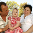 Grandmother with grandfather and granddaughter — Stock Photo #7433474