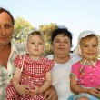 Grandmother with grandfather and grandchild — Stock Photo #7433476