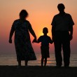 Grandfather with grandmother and the grandson against the background of sun — Stock Photo #7433540