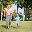 Grandfather with grandson run - Stockfoto