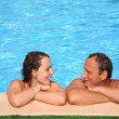 Woman and man at the pool board - Stock Photo