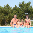 Woman and man with children at the pool board — Stock Photo #7433646