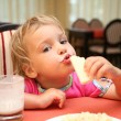 Stock Photo: Girl eats at restaurant
