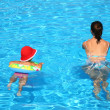 Mum and the daughter float in pool — Stock Photo