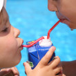 The brother and the sister drink juice — Stock Photo #7433838