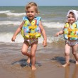 Stock Photo: Sisters leave sea