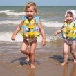 Sisters leave the sea — Stock Photo