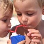 Children drink juice. — Stock Photo #7433890