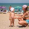 Stock Photo: Mother and the child on a beach.