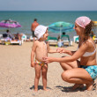 Mother and the child on a beach. — Stock Photo