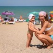 Mother and the child on a beach — Stock Photo