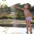 Child near the fountain — Stock Photo
