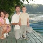 Family on the boat dock — Stock Photo