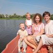 Family with the children in the boat — Stock Photo