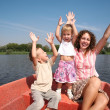 Merry mother with the children in the boat — Lizenzfreies Foto