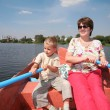 Woman and boy in the boat with the oars — Stock Photo #7434085