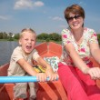 Stock Photo: Woman and boy in the boat with the oars 2