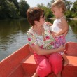 Woman with the girl in the boat — Stock Photo