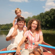 Family at the lake in the boat 2 — Foto Stock