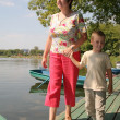 Woman with the boy on the moorage — Stockfoto