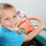 Boy in toy car — Stock Photo #7434162