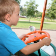 Boy in toy car 2 - Stock Photo