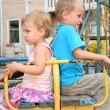 Quarrel boy and girl sit on the bench — Stock Photo